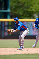 Tennessee Smokies third baseman Robel Garcia (4) throws to first base during a Southern League game against the Jacksonville Jumbo Shrimp on April 29, 2019 at Baseball Grounds of Jacksonville in Jacksonville, Florida.  Tennessee defeated Jacksonville 4-1.  (Mike Janes/Four Seam Images)