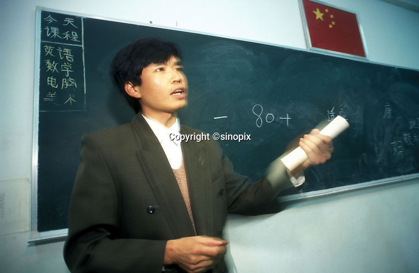A teacher gives a lesson at a private boarding school in Guanzhou, China.