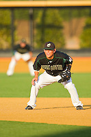 First baseman Justin Seager #10 of the Charlotte 49ers on defense against the Wake Forest Demon Deacons at Gene Hooks Field on March 22, 2011 in Winston-Salem, North Carolina.   Photo by Brian Westerholt / Four Seam Images