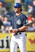 Asheville Tourists manager Warren Schaeffer (13) before a game against the Columbia Fireflies at McCormick Field on June 18, 2016 in Asheville, North Carolina. The Tourists defeated the Fireflies 5-4. (Tony Farlow/Four Seam Images)