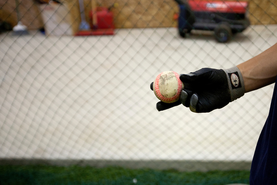 Brandon Nimmo shows a ball that has been colored to allow him to identify specific pitches during a tour of his family's batting cage on Tuesday, June 21, 2011, in Cheyenne, Wyo. (Photo by James Brosher)