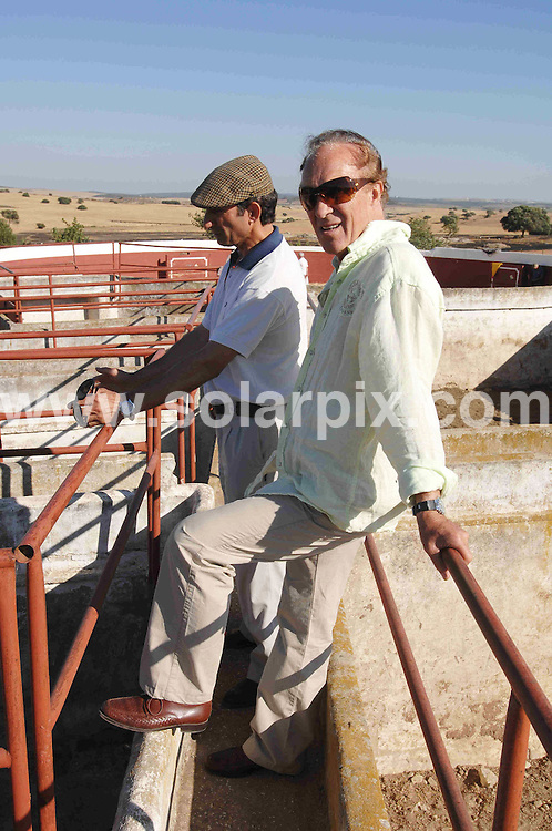 **ALL ROUND EXCLUSIVE  PICTURES FROM SOLARPIX.COM**.**WORLDWIDE SYNDICATION RIGHTS**.Frank Evans  who is 65 yrs old the last British bullfighter who has been fighting bulls in Spain since he was 17 yrs old he retired in 2005  pictured her in training in Chiclana Jerez De La frontera in Cadiz for his comeback...this pic: Jerez de la Frontera inspecting the bulls before practice ..JOB REF:6719-CS1         DATE:25_06_08.**MUST CREDIT SOLARPIX.COM OR DOUBLE FEE WILL BE CHARGED* *UNDER NO CIRCUMSTANCES IS THIS IMAGE TO BE REPRODUCED FOR ANY ONLINE EDITION WITHOUT PRIOR PERMISSION*