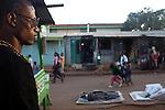 23-year-old hip-hop artist Octopizzo keeps his eye on the street in Kibera.