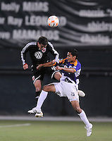 DC United defender Marc Burch (4) jumps to head the ball against Deportivo Saprissa forward Jairo Arrieta (19), Deportivo Saprissa defeated DC United 2-0,  in the first leg of group A of the Concacaf Champions League, Tuesday  September 16 , 2008 at RFK Stadium.