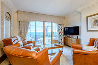 BNPS.co.uk (01202) 558833. <br /> Pic: TailorMade/BNPS<br /> <br /> Pictured: Tv room. <br /> <br /> A multi-millionaire is hoping to have a shot at selling his luxury mansion - by throwing a hi-tech golf simulator into the deal.<br />  <br /> Golf-loving Barry Bester put the waterfront property on Sandbanks, Dorset, on the market for £11m last year.<br />  <br /> He is now offering his £40,000 state-of-the-art simulator he has had built on the grounds with the sale.