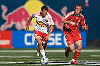 New York Red Bulls midfielder Jorge Rojas (13) is marked by Toronto FC forward Chad Barrett (19). The New York Red Bulls defeated Toronto FC 2-0 during a Major League Soccer match at Giants Stadium in East Rutherford, NJ, on August 17, 2008.