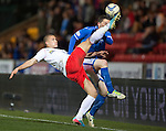 St Johnstone v Ross County...15.03.14    SPFL<br /> Erik Cikos clears from Gary McDonald<br /> Picture by Graeme Hart.<br /> Copyright Perthshire Picture Agency<br /> Tel: 01738 623350  Mobile: 07990 594431