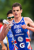 24 JUN 2012 - KITZBUEHEL, AUT - Jonathan Brownlee (GBR) of Great Britain tries to cool himself with water during the run at the elite men's 2012 World Triathlon Series round in Schwarzsee, Kitzbuehel, Austria (PHOTO (C) 2012 NIGEL FARROW)
