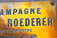 A polished brass sign at the winery of Louis Roederer, Reims, Champagne, Marne, Ardennes, France