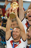 Shkodran Mustafi of Germany lifts the World Cup trophy after winning the 2014 final