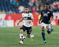 FOXBOROUGH, MA - JULY 18: Lucas Venuto #7 attempts to control the ball as DeJuan Jones #24 closes during a game between Vancouver Whitecaps and New England Revolution at Gillette Stadium on July 18, 2019 in Foxborough, Massachusetts.