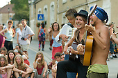 Buskers in the main village street during the 31st International Festival of Luthiers and Maitres Sonneurs, in Saint Chartier, France.