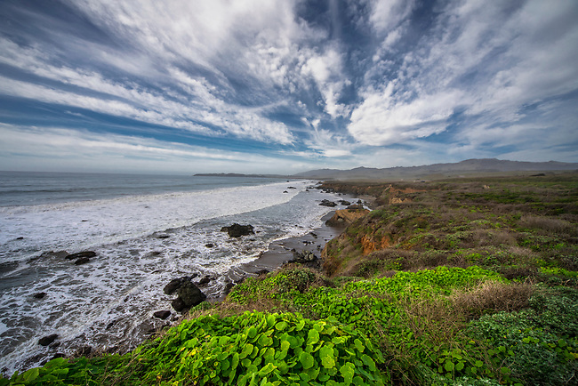 Waves crash along the coastline near San Simeon, California.