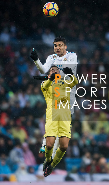 Carlos Henrique Casemiro (up) of Real Madrid competes for the ball with Pablo Fornals of Villarreal CF during the La Liga 2017-18 match between Real Madrid and Villarreal CF at Santiago Bernabeu Stadium on January 13 2018 in Madrid, Spain. Photo by Diego Gonzalez / Power Sport Images