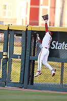 Arkansas right fielder Cayden Wallace reaches to make a play on a home run hit Thursday, April 1, 2021, by Auburn second baseman Brody Moore during the third inning of play against Auburn at Baum-Walker Stadium in Fayetteville. Visit nwaonline.com/210402Daily/ for today's photo gallery. <br /> (NWA Democrat-Gazette/Andy Shupe)