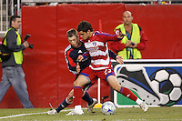 New England Revolution midfielder Steve Ralston (14) and FC Dallas defender Blake Wagner (23). The New England Revolution defeated FC Dallas 2-1 during a Major League Soccer match at Gillette Stadium in Foxborough, MA, on June 6, 2008.