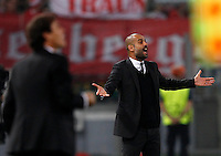 Calcio, Champions League, Gruppo E: Roma vs Bayern Monaco. Roma, stadio Olimpico, 21 ottobre 2014.<br /> Roma's coach Rudi Garcia, left, and Bayern's coach Josep Guardiola give suggestions to their players during the Group E Champions League football match between AS Roma and Bayern at Rome's Olympic stadium, 21 October 2014.<br /> UPDATE IMAGES PRESS/Isabella Bonotto