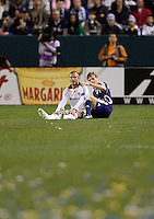 New York Red Bulls midfielder Dave Van Den Bergh (11) and LA Galaxy midfielder and captain David Beckham (23) after falling to the pitch during a MLS match. The New York Red Bulls defeated the LA Galaxy 2-1 at Home Depot Center Stadium, in Carson, Calif., on Saturday, May 10, 2008.