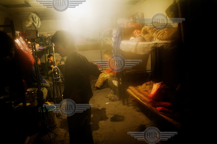 Migrant workers in their dormitory accomodation.