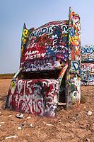 Graffitti covered Cadillac at Cadillac Ranch along Route 66 east of Amarillo, Texas.