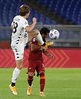 Roma s Pedro, right, is challenged by Benevento s Pasquale Schiattarella during the Serie A soccer match between Roma and Benevento at Rome's Olympic Stadium, October 18, 2020.<br /> UPDATE IMAGES PRESS/Riccardo De Luca