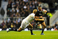 Aaron Cruden of New Zealand is tackled by Billy Twelvetrees of England during the QBE Autumn International match between England and New Zealand at Twickenham on Saturday 16th November 2013 (Photo by Rob Munro)