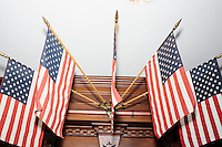 Flags stand hang above a memorial before Texas senator and Republican presidential candidate Ted Cruz speaks at a town hall put on by the Concerned Veterans for American at Milford Town Hall in Milford, New Hampshire.