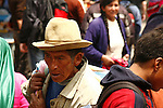 A Peruvian man weeds his way through the crowds at the Pisac market.