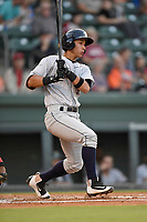 Second baseman Oswaldo Cabrera (9) of the Charleston RiverDogs bats in Game 2 of the South Atlantic League Southern Division Playoff against the Greenville Drive on Friday, September 8, 2017, at Fluor Field at the West End in Greenville, South Carolina. Charleston won, 2-1, and the series is tied at one game each. (Tom Priddy/Four Seam Images)