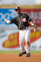 Second baseman Greg Picart (7) of the Hickory Crawdads makes a throw to first base at L.P. Frans Stadium in Hickory, NC, Sunday, August 17, 2008.