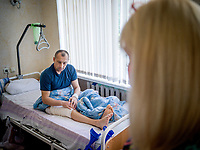 Natalia Voronkova visits a wounded soldier at the main military hospital in Kiev. The soldier was wounded in the leg by shrapnel from a mortar while fighting the Russian-backed separatists in the Donbass region. Natalia and other volunteers visit hospitalised soldiers on a daily basis to support them in any way they can.