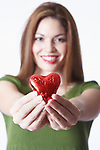 Woman holding heart shape Valentine's gift, portrait