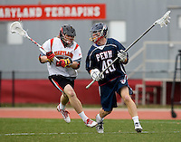 John Haus (26) of Maryland tries to catch up to Brendan Saxon (40) of Penn at Ludwig Field in College Park, Maryland.
