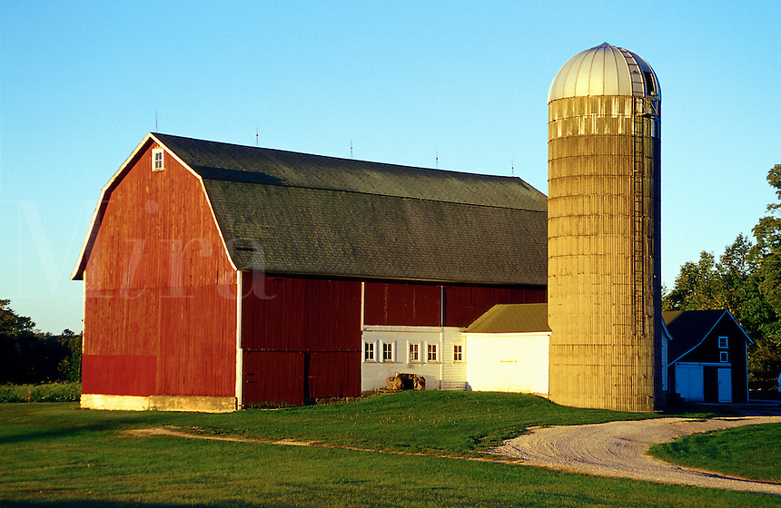 Rural scene of a large red barn and silo. Gills Rock, Door County, Wisconsin.