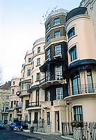 London: Houses, Park Lane, 1820's. Bow windows, iron balcony railings.