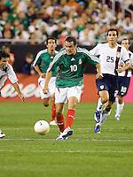 Cuauhtemoc Blanco passes the ball. USA 2, Mexico 0, at the University of Phoenix Stadium in Glendale, AZ on February 7, 2007.