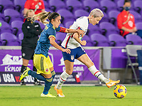 ORLANDO, FL - JANUARY 22: Megan Rapinoe #15 of the USWNT passes the ball during a game between Colombia and USWNT at Exploria stadium on January 22, 2021 in Orlando, Florida.