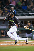 Tim Anderson (7) of the Charlotte Knights follows through on his swing against the Columbus Clippers at BB&T BallPark on May 3, 2016 in Charlotte, North Carolina.  The Clippers defeated the Knights 8-3.  (Brian Westerholt/Four Seam Images)