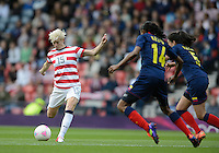 Glasgow, Scotland - Saturday, July 28, 2012: Megan Rapinoe of the USA Women's soccer team scores a goal during a 3-0 win over Colombia in the first round of the Olympic football tournament at Hamden Park.