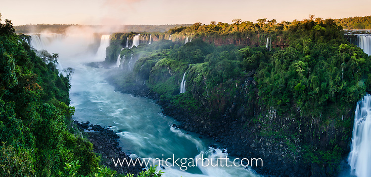 Iguasu Falls at sunrise (also Iguazu Falls, Iguazú Falls, Iguassu Falls or Iguaçu Falls) on the Iguasu River, Brazil / Argentina border. Photographed from the Brazilian side of the Falls. State of Paraná, Brasil.