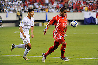 Roman Torres (5) of Panama is chased by Brian Ching (11) of the United States (USA). The United States (USA) defeated Panama (PAN) 2-1 during a quarterfinal match of the CONCACAF Gold Cup at Lincoln Financial Field in Philadelphia, PA, on July 18, 2009.