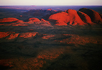 Aerial view of the Olgas at Sunset,with Ayers Rock Uluru in the distance. National Park, Northern Territory, Central Australia