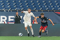 FOXBOROUGH, MA - AUGUST 5: Max Flick #4 of North Carolina FC passes the ball as Justin Rennicks #12 of New England Revolution II pressures during a game between North Carolina FC and New England Revolution II at Gillette Stadium on August 5, 2021 in Foxborough, Massachusetts.