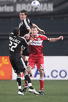 Chicago Fire forward Brian Mcbride (20) tries to head the ball while covered from behind by DC United defender Marc Burch (4) and midfielder Rodney Wallace (22), Chicago Fire tied  DC United 1-1 at  RFK Stadium, Saturday March 28, 2009..