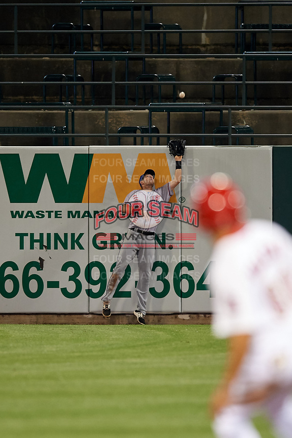 Round Rock Express right fielder Jared Hoying (30) tracks a fly ball at the fence during a game against the Memphis Redbirds on April 28, 2017 at AutoZone Park in Memphis, Tennessee.  Memphis defeated Round Rock 9-1.  (Mike Janes/Four Seam Images)