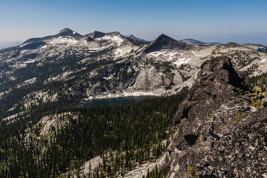A hiker's view just a few feet from the top of Harrison Peak in North Idaho's Selkirk Range.  Harrison Lake is seen below.