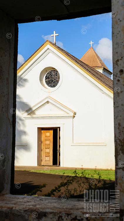 A view of old St. Raphael's Catholic Church through the rectory portal, Koloa, Kaua'i.