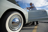 Bill Crawford preps his 1960 VW Karmann Ghia during the 11th Annual VW Family Reunion Car Show at the Dimond Center.