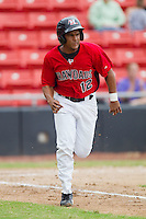 Yefry Castillo #12 of the Hickory Crawdads hustles down the first base line against the Kannapolis Intimidators at  L.P. Frans Stadium August 1, 2010, in Hickory, North Carolina.  Photo by Brian Westerholt / Four Seam Images