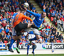 St Johnstone's Dave Mackay is pushed off the ball = by Dundee Utd's Nadir Ciftci.